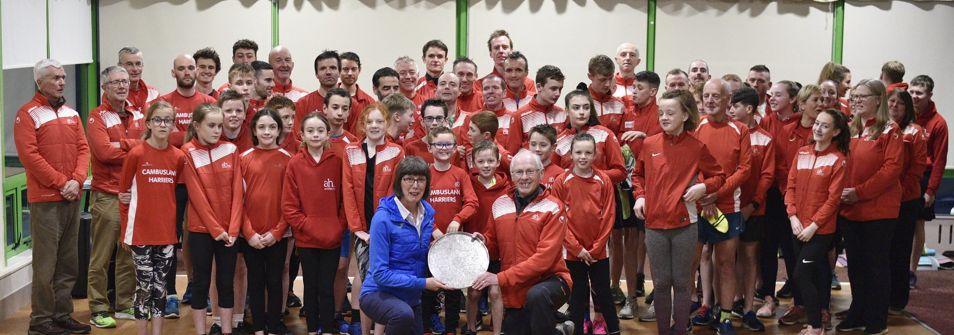 Members of Cambuslang Harriers witness the presentation of the AT Mays shield